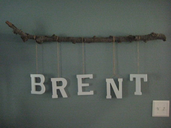 Going to DIY this with a painted white branch and prettier letters