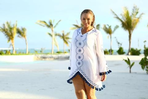 This fine Embroidered Navy Kaftan from jamjam Clothing has delicate print with a soft cotton finish created from gorgeous cotton material inspired by artsy market fashion. It's classic styling with a short kaftan shape is wearable with a simple slip or down at the beach with your bikini underneath.