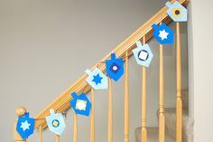 Hanukkah crafts for kids - love the felt dreidel garland and must remember to put it on stairs