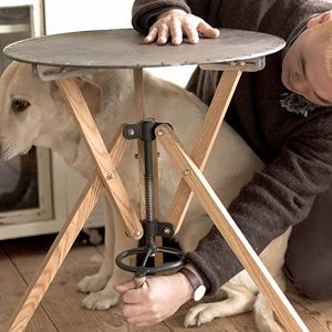 Adjustable height table.  The site is in Japanese, but presents a very cool concept in furniture design