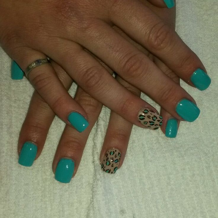 Acrylic nails with tiffany blue polish and leopard print.  #leopardnails #bluenails #naildesigns done by @Michelle Stephenson on IG. WWW.FACEBOOK.COM/MRSSTEPHENSON13