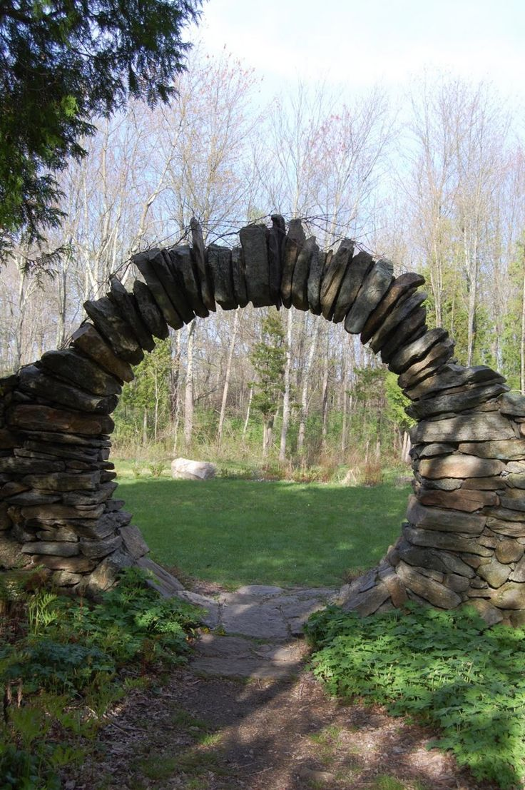 A stone moongate.  It looks like this was made the old-fashioned way by carefully fitting the stones together, using clever engineering rather than mortar to reinforce the structure.