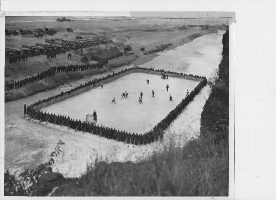 """Final game of the 25th Canadian Infantry Brigade's hockey championship series at """"Imjin Gardens."""" Korea. February 1953"""