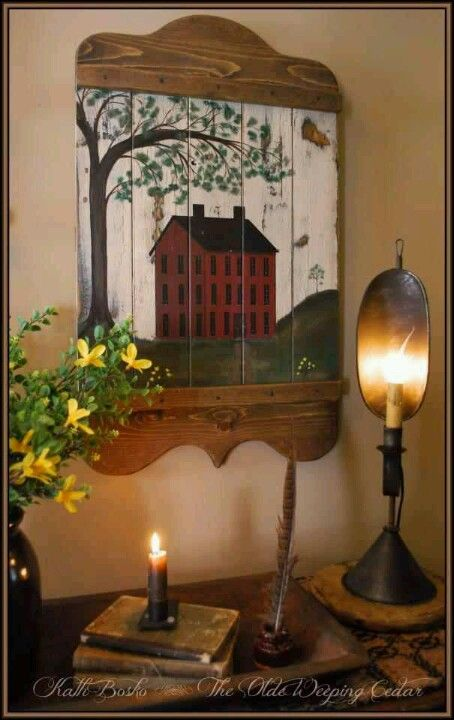How sweet is this setting. The old school house painting and the added candle lighting makes for a welcome country ambiance.
