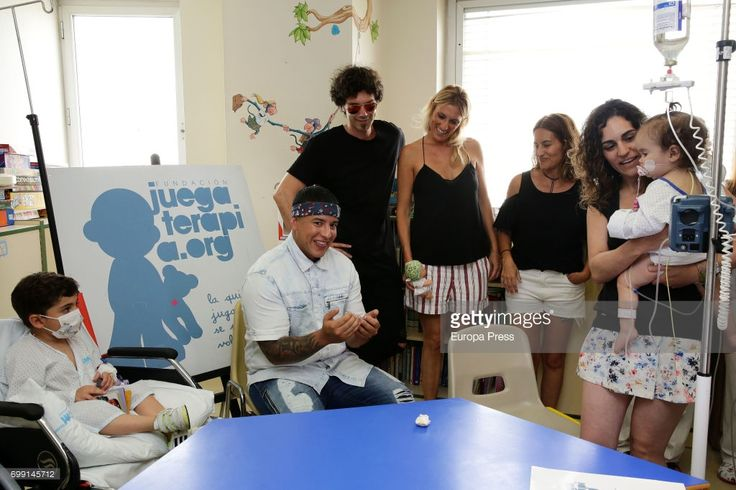 Daddy Yankee (2L), Pablo Ibañez (3L) and Monica Esteban (4L) visit chidren at Childhood Oncology area at La Paz Hospital organized by the Juegaterapia Foundation that fight against childhood cancer on June 19, 2017 in Madrid, Spain.