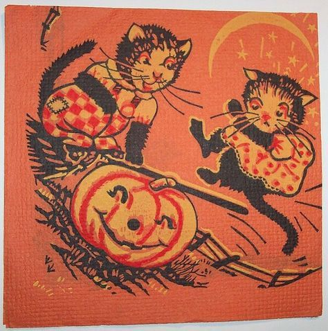 I've been considering donning some ears and whiskers for a simple Halloween costume. Nothing's quite as seasonal as an arched black cat.