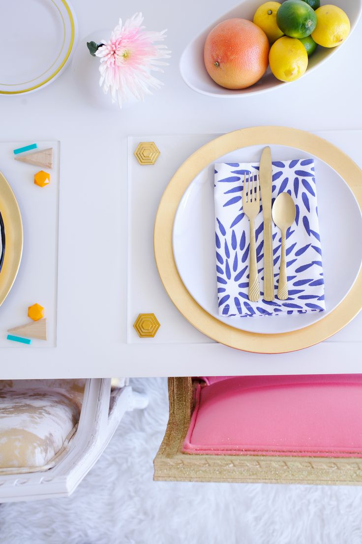 Our lucite placemats and mums the word linens.and metallic, sparkly chairs.