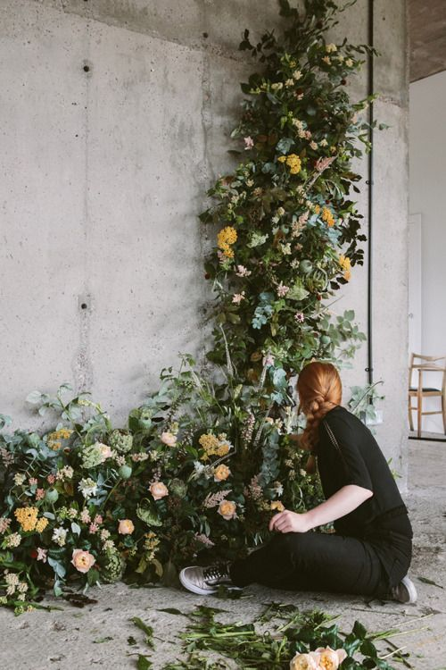 This floral backdrop is coming together beautifully.