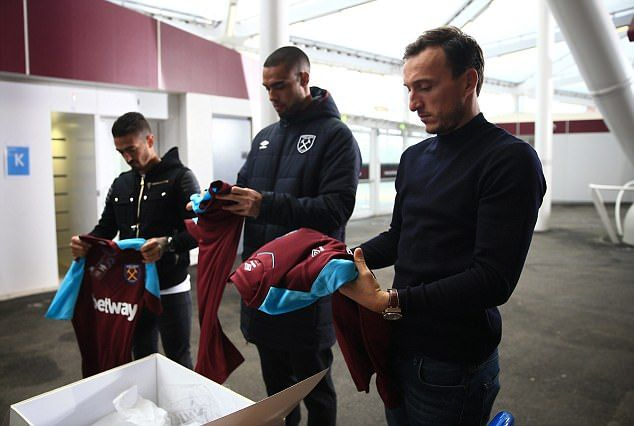 Manuel Lanzini, Winston Reid and Mark Noble take a glance at their new shirts
