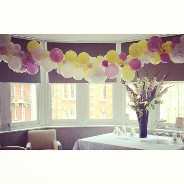 Freestyle balloon garland with incorporated tissue pom poms. Just one of the beautiful parties from 2015. #balloons #aballoon #balloongarland #pompoms #party