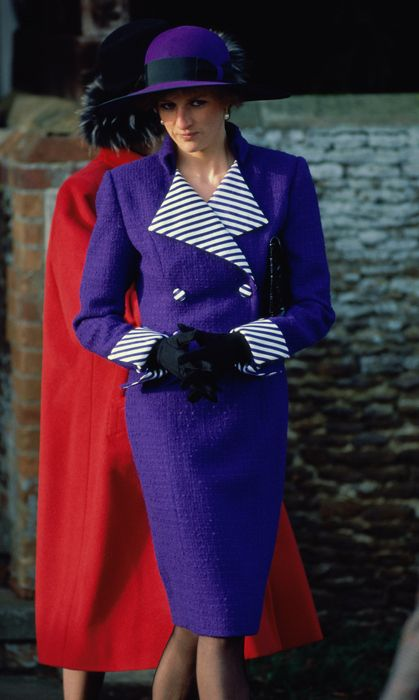 Princess Diana at a Christmas Day service at Sandringham Church, December 25, 1989. Diana donned this vibrant purple suit with striped detailing and a wide-brimmed, feathered hat to match. (Photo by Anwar Hussein/Getty Images)