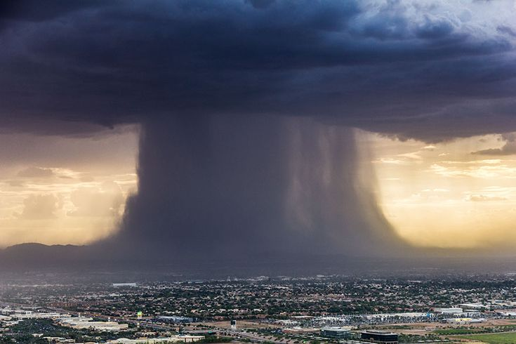 Incredibly Powerful Microburst Storm Photographed Above Phoenix  -  Earlier this week, a microburst was hovering above Pheonix, Arizona. One photographer named Jerry Ferguson was in the right place at the right time and managed to take a breathtaking photo of it.