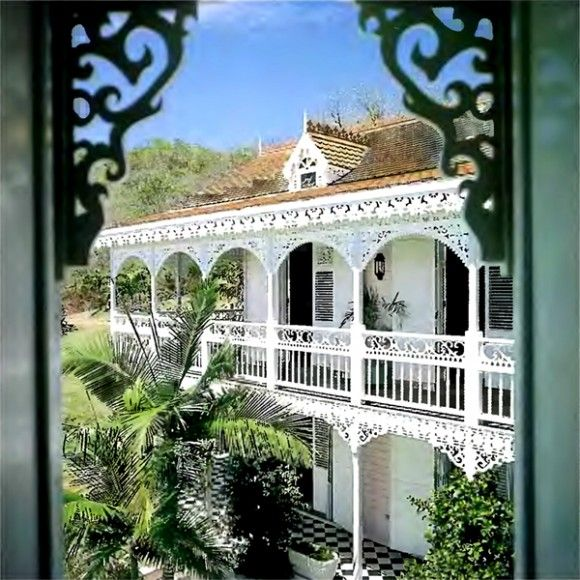 Many British colonist, builders & architects adapted prevailing Victorian fashions into homes far removed from 'dear old England'. Nostalgia played a large part in colonial architecture around the world, from the Caribbean to Australia & New Zealand. In St Lucia particularly, the 'Gingerbread' house – All lacy fretwork verandas, barge-boards & railings – became the traditional style.