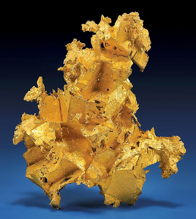 Native Gold Epimorph!  Stunning and quite heavy specimen which formed when Gold rich fluids filled a pre-existing vug of Quartz  crystals and Ankerite. When both minerals later dissolved, they left behind their distinct crystal habits  embedded in the dense, solid nugget of nearly pure Native Gold.