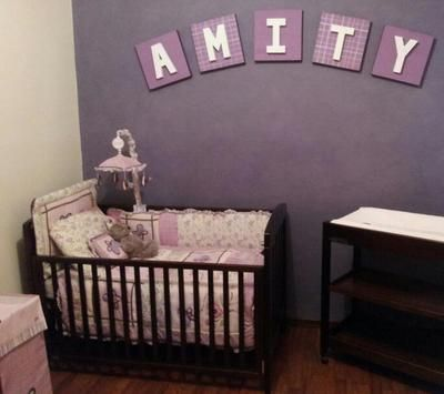 Baby Girls Nursery With A Dusty Purple Accent Wall And Lavender Crib Bedding