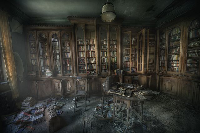 library ghosts  : by andre govia., via Flickr  The Manor library was very dusty and the smell of decay and paper was really still and creepy .