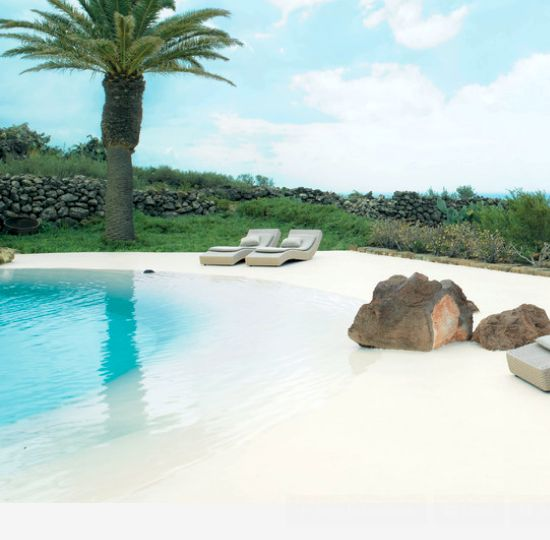 Beach feeling right at home with a beach entry pool, aka zero entry pool. http://beachblissliving.com/heavenly-beach-entry-pool-ideas/