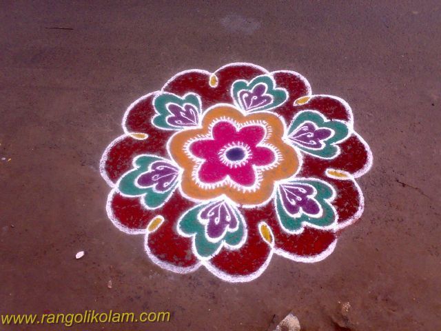 Flower kolam design This is a very simple flower rangoli kolam done it my own idea and creation .....It isvery simple rangoli kolam ..... so you can try this in your entrance....with differen...