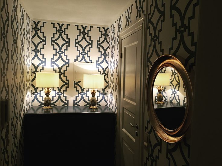 Hallway in the apartment. Wallpaper and pineapple Lamps