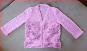 Knitting pattern for a ladies V neck jacket with 3/4 sleeves.