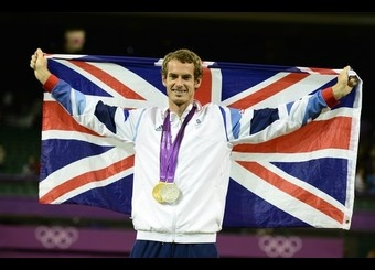 Great Britain's Andy Murray poses with his gold medal won in the men's single tournament and the silver, won in the mixed doubles along with compatriot Laura Robson, during a ceremony at the end of the London 2012 Olympic Games tennis tournament, at the All England Tennis Club in Wimbledon.