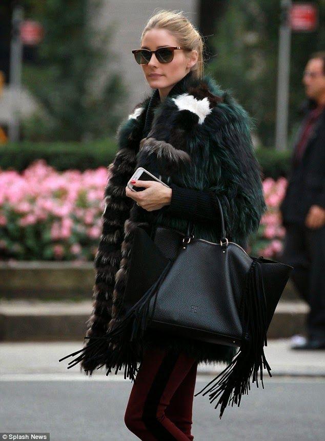 Olivia Palermo with the #CHCarolinaHerrera suede fringe bag