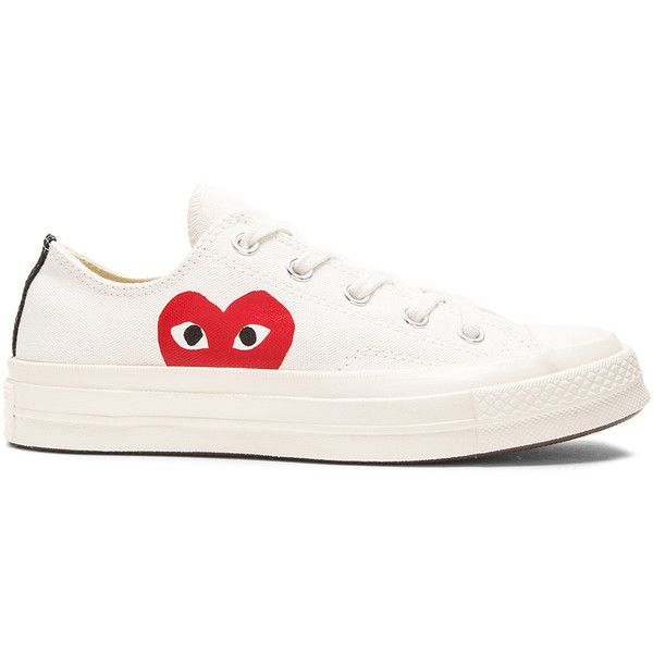 Comme Des Garcons PLAY Converse Large Emblem Low Top Canvas Sneakers (£94) ❤ liked on Polyvore featuring shoes, sneakers, low top, low profile sneakers, plimsoll shoes, canvas sneakers and plimsoll sneaker