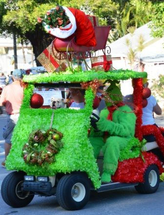The Grinch (Matt Wilhide) drives the REMAX golf cart in the Captiva Holiday Parade