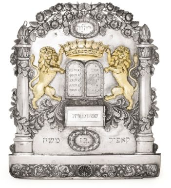 A parcel-gilt silver Torah shield, probably Romanian, c.1830-50; the Tablets of the Law are crowned and supported by lions; at the top is the tetragrammaton. (Sotheby's)