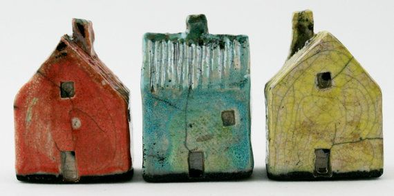 Three tiny Raku Houses are just right to make your own old world street scene. These house are glazed in pastel colors for added effect and