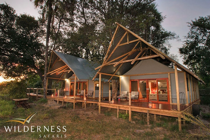 Chitabe Lediba - Its two family units have adjoining bedrooms and en-suite bathrooms. All five spacious Meru-style tents are built on raised decks. #Safari #Africa #Botswana #WildernessSafaris