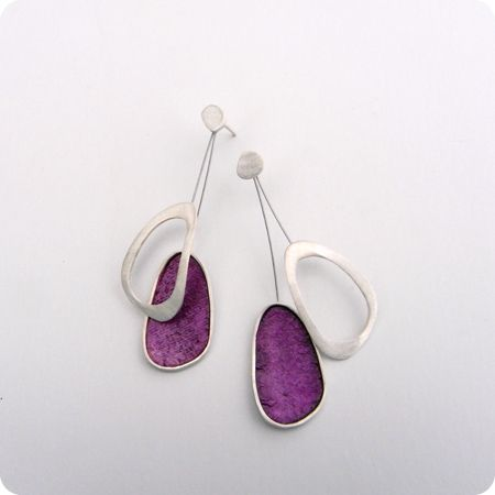 Silina Jewellery Designer. Make 2 hanging reflective shapes - one solid & one cut. No stones.