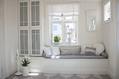 This bench under the window is absolutely adorable! And i love the doors for the cabinet.