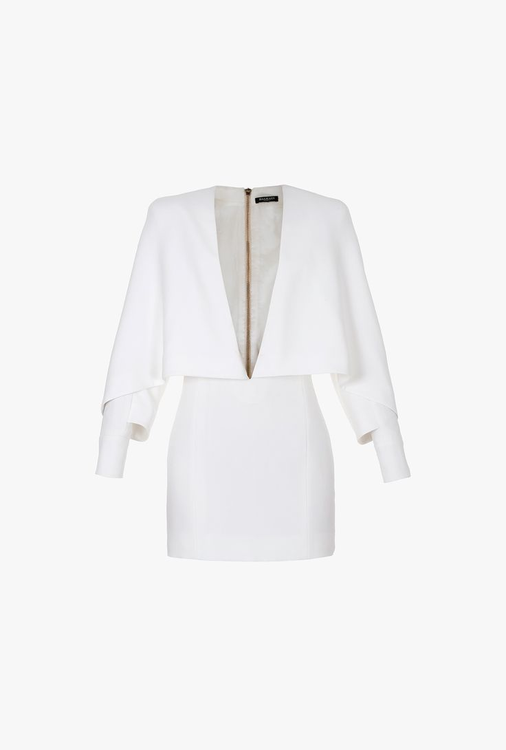 Balmain, Resort 2015, Key item of the collection, this crepe and viscose mini-dress is embellished with a plunging neckline and a poncho-like effect, for a very modern and sexy outfit.