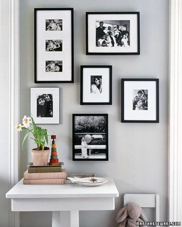 Spiral Photo Arrangement  To create a quiet corner of variously sized black-and-white pictures, have photos mounted in frames of the same color or design. Two or three pictures identical in size can be matted together. Hang the frames in a loose spiral pattern with your favorite picture at the center.