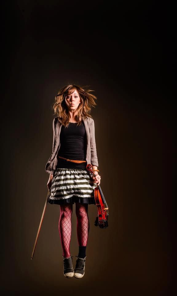 The skirt and shoes with the fishnet is nerdy but in a fashionable way rather than an awkward way, which is so cool.