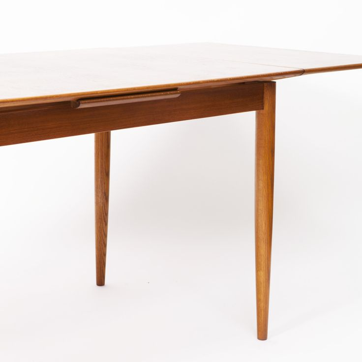 This fantastic Danish Modern extendable dining table features a beautiful amber teak frame and elegant, round tapered legs.  With an initial small footprint, this table can also offer a generous space and double in size once its draw leaves are deployed. If you are also looking for a matching set of dining chairs, we might have what you need! Click here and check out this set of 6 Danish vintage dining chairs.