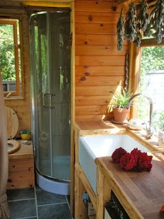 Kitchen and bathroom with composting toilet. Excellent tiny home and house truck site.