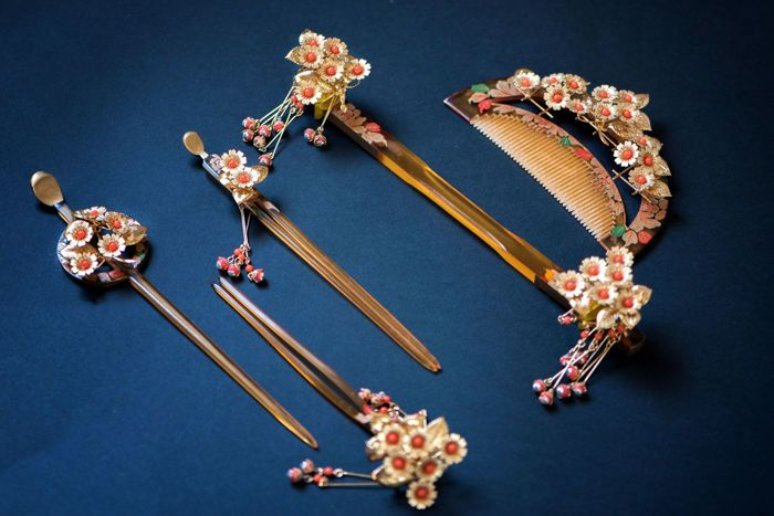 The middle of the 20th century,  beautiful traditional wedding set jewelry for the bride hairstyle. In very good condition. Very beautiful gilded metal construction. Each flower is decorated with natural coral. Hand painting using a golden paste (Makie).  You can see a flowering sakura. Sakura - known symbol of Japan and Japanese culture. Amaizing work that reveals the beauty of Sakura. Sakura is a traditional symbol of feminine youth and beauty.  Complete with original box.  On each…