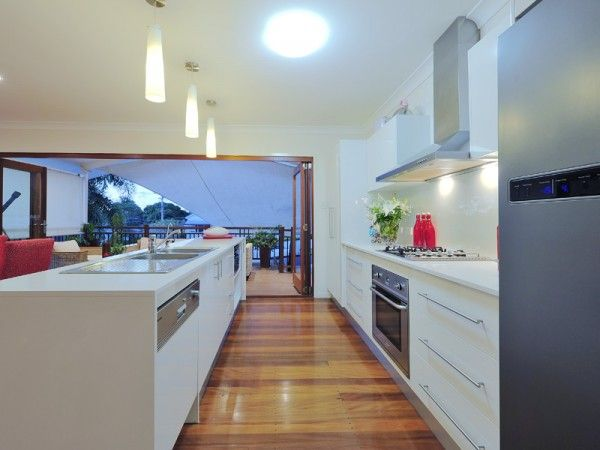 Open plan kitchen & living area Rs: like the wood floors, clean lines out to deck