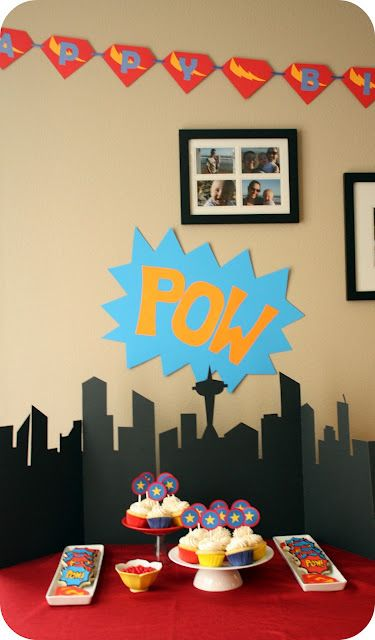 Superhero theme....love the city back drop they cut out