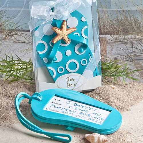 "Your guests will never have trouble recognizing their luggage again when they use these Flip Flop Luggage Tag Wedding Favors! They probably won't be able to resist the urge to smile every time either...these destination wedding favors will add a relaxed, vacation-like feel to your special day.Each measures 4"" x 2.5""Aqua blue rubberized luggage tag in the playful and fun shape of a flip flop, complete with a modern white bubble patterned design and a blue strap with an adorable starfish…"
