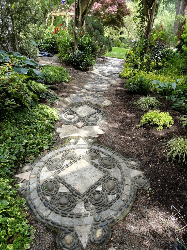 Pebble Mosaic Path, a compass rose and - is that an owl above it?