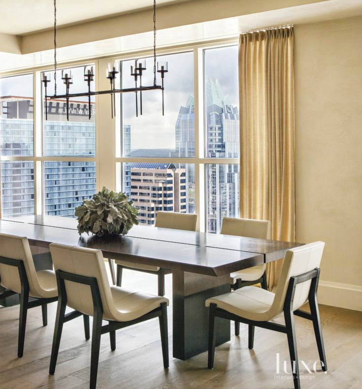 The Classic Dining Room Features Furnishings That Are Offset By A Contemporary Alison Berger Glassworks Chandelier