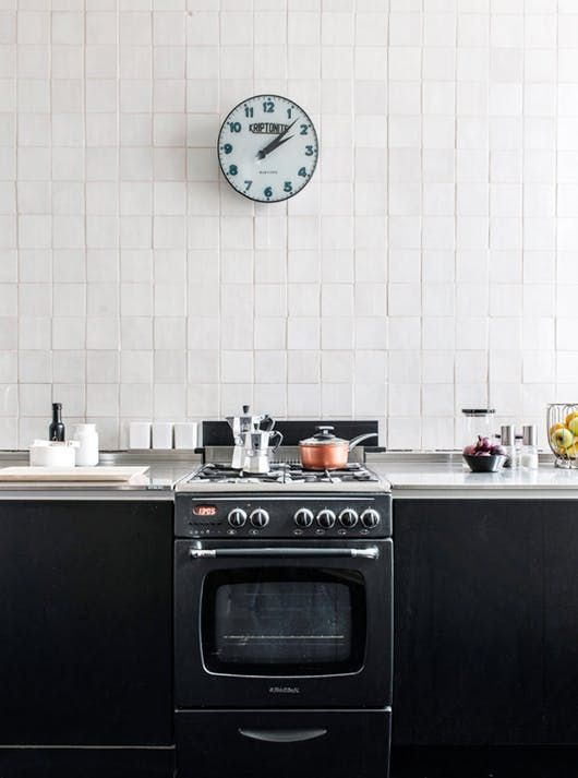 Zellige tiles, the glazed Moroccan tiles with the subtle ripply texture and deep, rich colors, are especially striking in a modern kitchen.