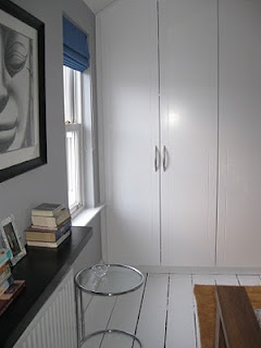 My main bedroom: Floating Lack wall shelf from Ikea, wardrobes from Bedroom Elegance. Floor painted in Ronseal Diamond Floor Paint in White. Walls in Dulux Modernism. http://motheach.blogspot.com
