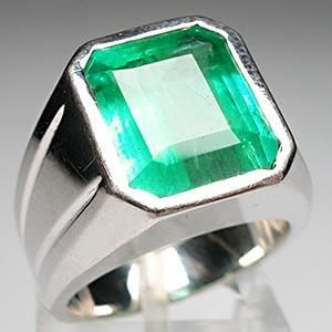 Emerald men's ring. Prolific gemstone throughout history, the faintly bluish green gemstone known as emerald provides the inspiration behind Pantone's 2013 color of the year.