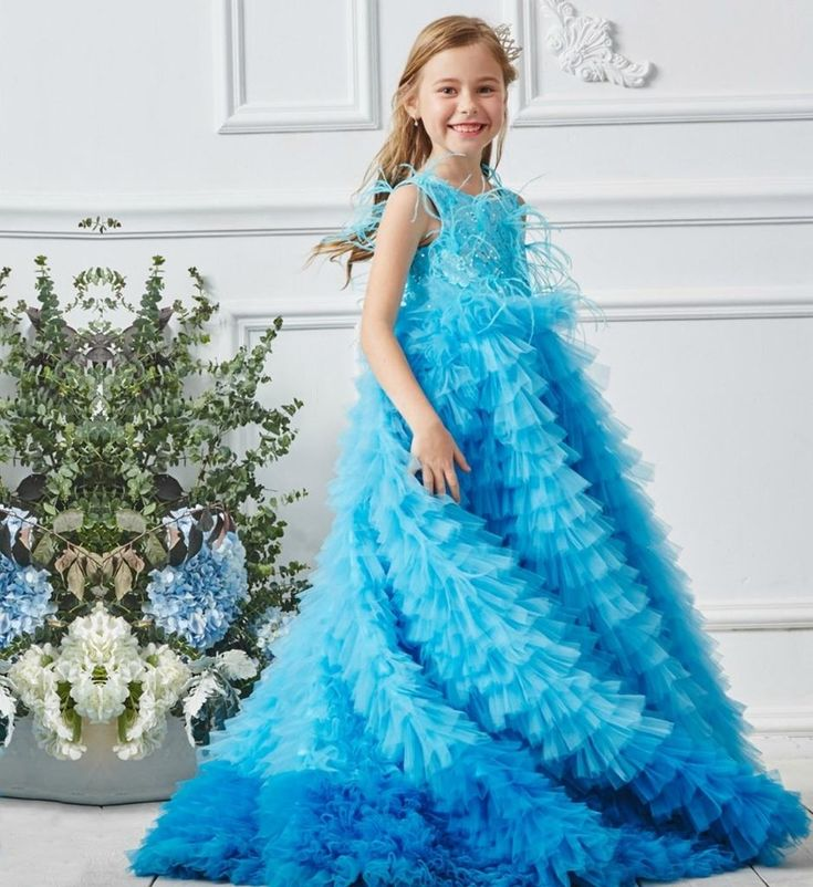 Ostrich Feathers Ball Gown-Made To Order - High Quality Beautiful Lace Sequin Ostrich Feathers Applique Round Neckline Sleeveless Floor Length Little & Big Girl Gradient Puffy Ball Gown. Available from 2 until 13 years. Material: Cotton, organza, tulle mesh. Color: Sky Blue. Please do compare your little girl's measurements with our size chart.