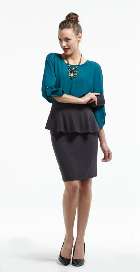 Statement necklace and sparkly clutch add glitter to this Plum Teal Blouse and Tobias Peplum Skirt in Grey.