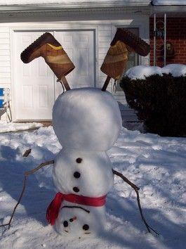 Schneemann im Kopfstand